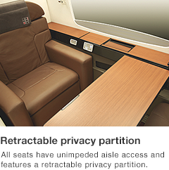 All seats have unimpeded aisle access and features a retractable privacy partition.